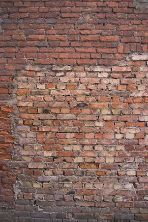 xx century: Brick wall. An old bricklaying (the beginning-middle of XX century) and part of new brick (end XX century) Stock Photo