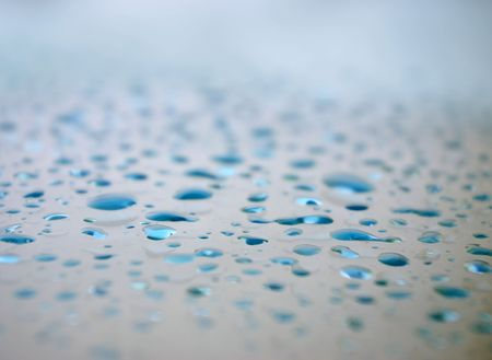 horisontal: Drops of water on a smooth surface (glass). Small light dops. Focus on centr (horisontal).