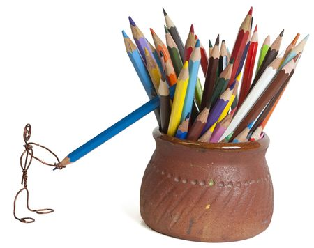 The little man from a wire drags a colour wooden pencil Stock Photo - 4583038