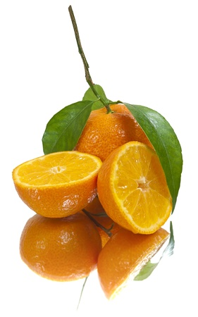 Juicy tangerines just out of the box. Real mirror. Stock Photo - 8288094