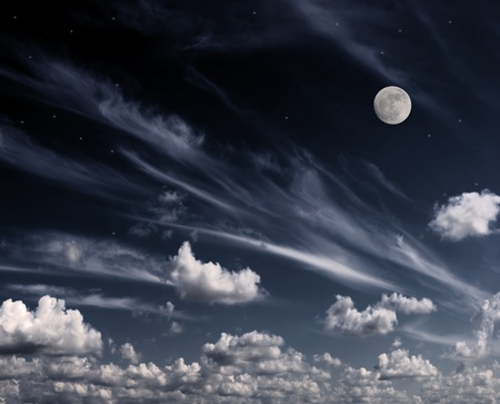 Moon in the night sky. Clouds and stars above them. Processed on a computer. Stock Photo - 10927450