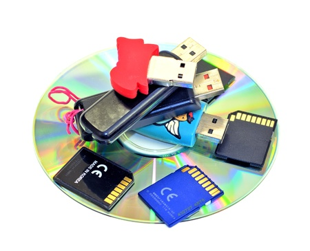 usb storage device: Small pile of USB Flash Drives, SD cards, CDROM