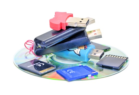 Small pile of USB Flash Drives, SD cards, CDROM Stock Photo - 11301272