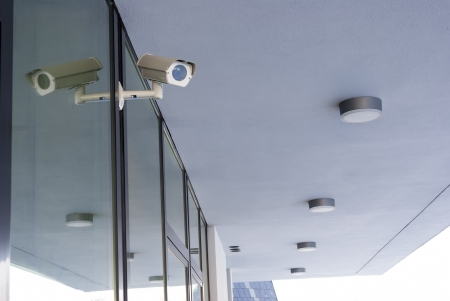 Camera system guarding office building with white housetop in horizontal format