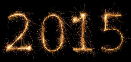 aggregated: Number 2015 written with a sparkler (aggregated from fotos). Stock Photo