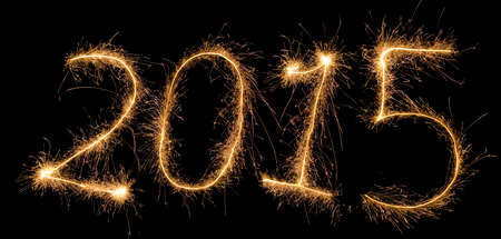 Number 2015 written with a sparkler (aggregated from fotos). Only first numbers is italic.