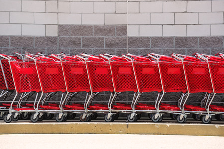 shopping carts in front of brick wall
