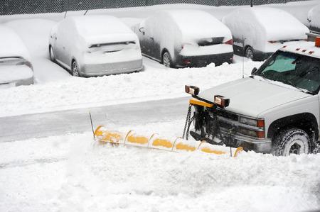 snowplow removing snow on the street after blizzard Foto de archivo