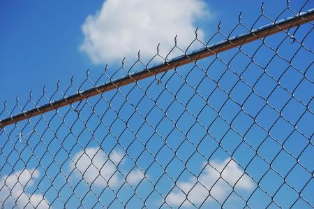 chainlink fence: iron chainlink fence against sky