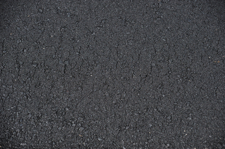 the road surface: new paved road surface asphalt background