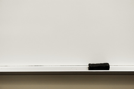 close up on white board eraser and board in classroom