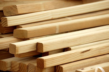 details of piles of wood beams in construction site