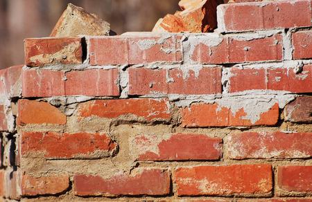 damaged: old damaged brick wall background