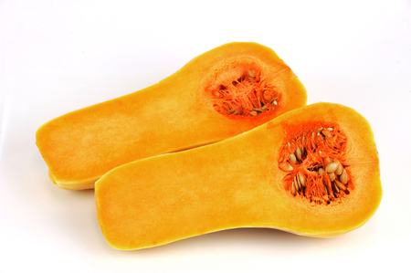 butternut: butternut squash cut in halves isolated on white background