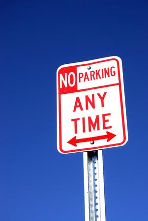 no parking sign: no parking sign against blue sky