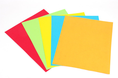 stacking colored papers isolated in white background