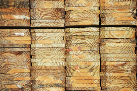 construction material: neatly stacked wood beam with texture and cross section as construction material