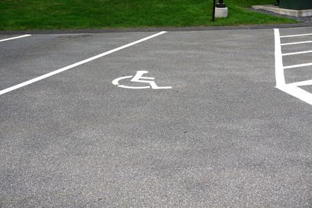 handicap sign: handicap sign on the road surface of parking lot