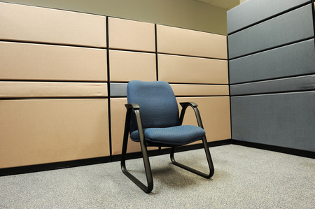 cubicle: single chair in empty cubicle