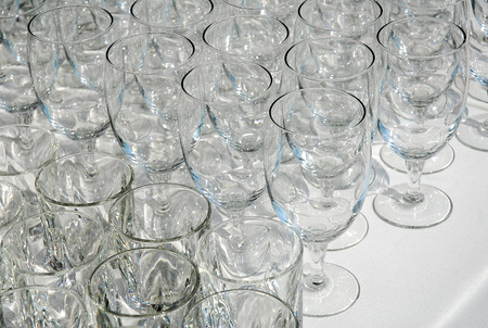 clean wineglasses on the table for dinner