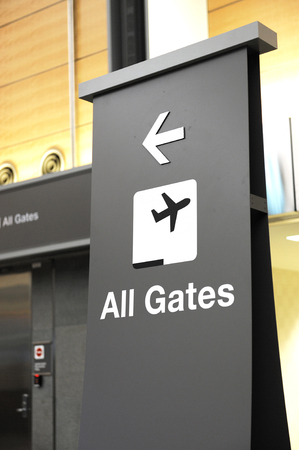 directional sign: directional sign indicating airport gates for boarding