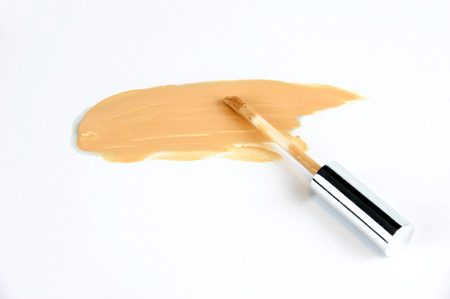 makeup foundation smear on white background