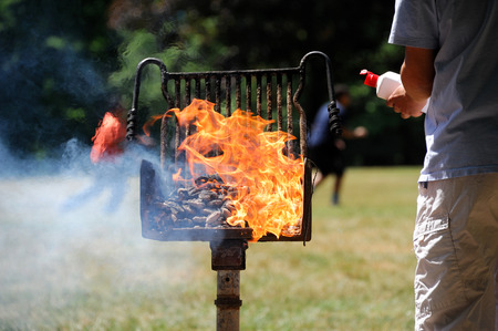 igniting: man start barbecue and igniting the coal by fire starter