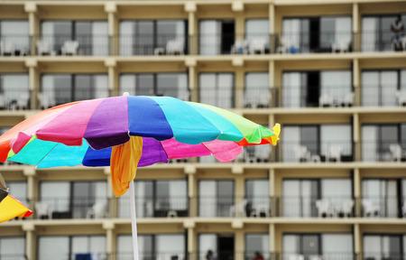 hotel building: sun umbrella in front of hotel building Stock Photo