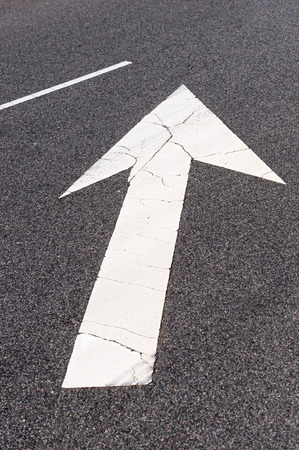 road surface: directional arrow sign painted on road surface Stock Photo