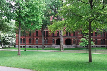 harvard university: Harvard University Campus, ancient brick building and lawn in spring Stock Photo
