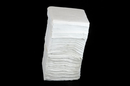stack of paper: stack napkins isolated on black background