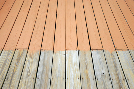 partially: partially painted old wood deck Stock Photo