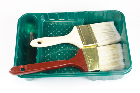 paint container: paint brushes and paint container Stock Photo