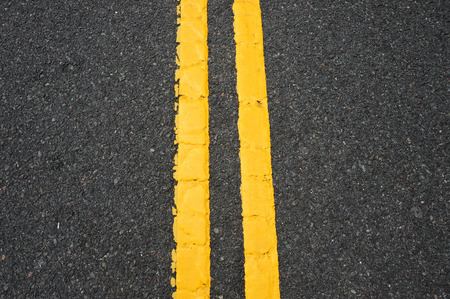 road surface: double yellow line on asphalt street surface