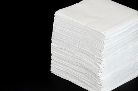stack napkins isolated on black background
