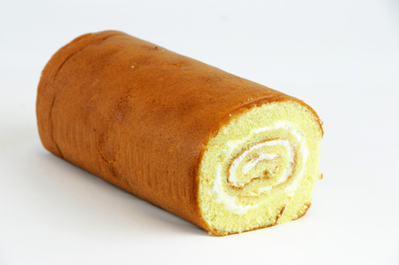 sweet background: fresh cake roll on white background