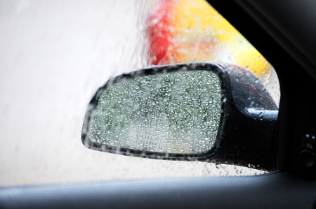 rain drops on car side view mirror and window Imagens