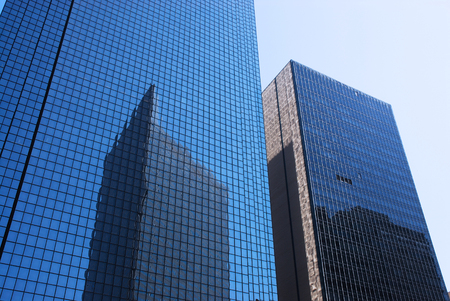 office building reflecting in the blue glass wall Stock Photo