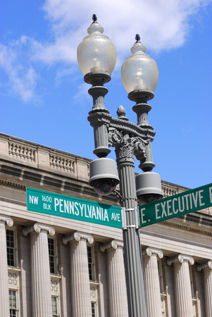 ave: Pennsylvania Ave street sign on lamp against old building
