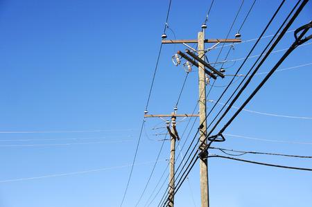 telephone poles: power pole under blue sky, vertical composition Stock Photo
