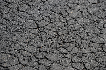 road surface: cracked asphalt road surface texture Stock Photo