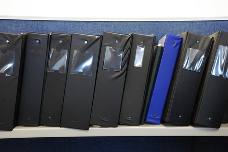 stacking document folder on the shelf