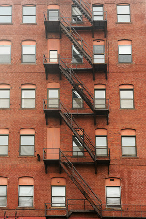 escape: old building with iron fire escape stairs