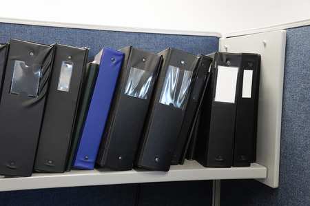 stacking document folder on the shelf