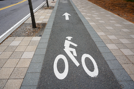 bicycle sign on the sidewalk in the city Stock Photo