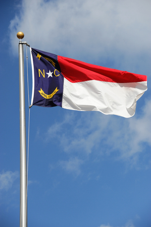 North Carolina State flag waving under sky Stock Photo