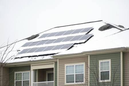 solar panel on the roof covered by snow after blizzard in winter Stok Fotoğraf - 72658207