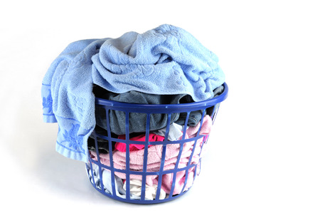 messy clothes: clothes wash basket isolated on white background