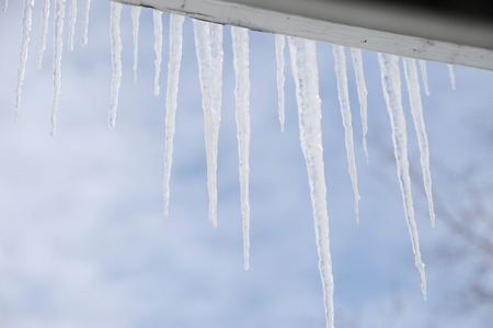 close up on icicle hanging on the roof Stock Photo