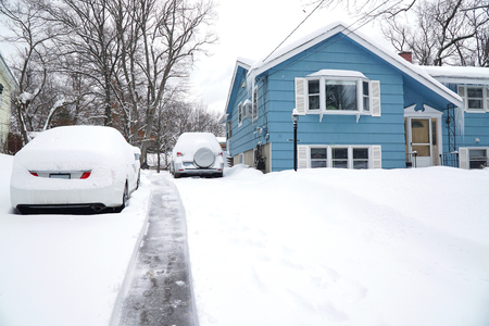 snow removal on driveway after blizzard in residential district Banco de Imagens